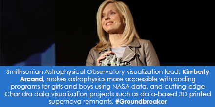Portrait of Kimberly Arcand holding astrophysical model