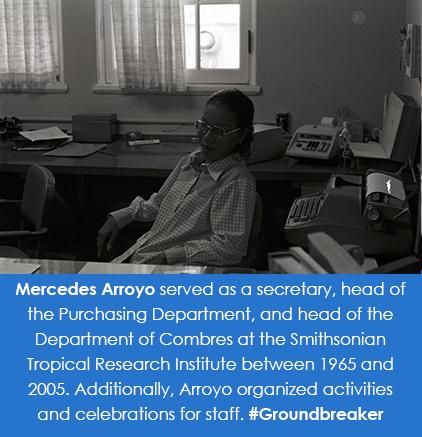 Mercedes Arroyo sits at a desk.