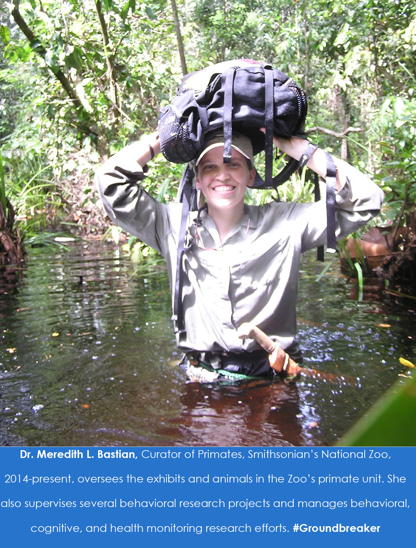 A person wades through water with a backpack over their head.