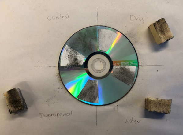 A soot-covered disc has four sections labeled