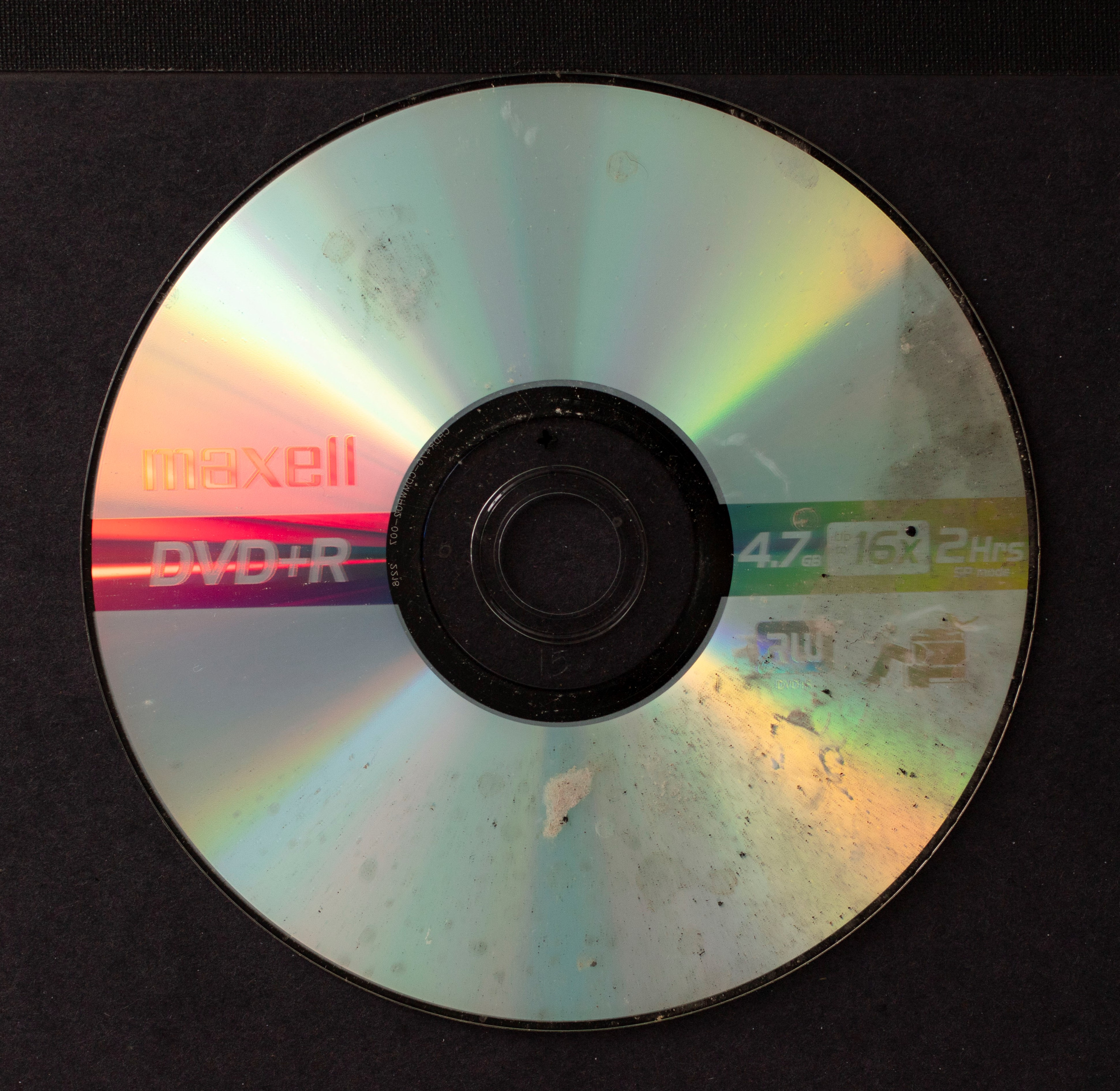 Water spots cover about half of the surface of the front side of a DVD.