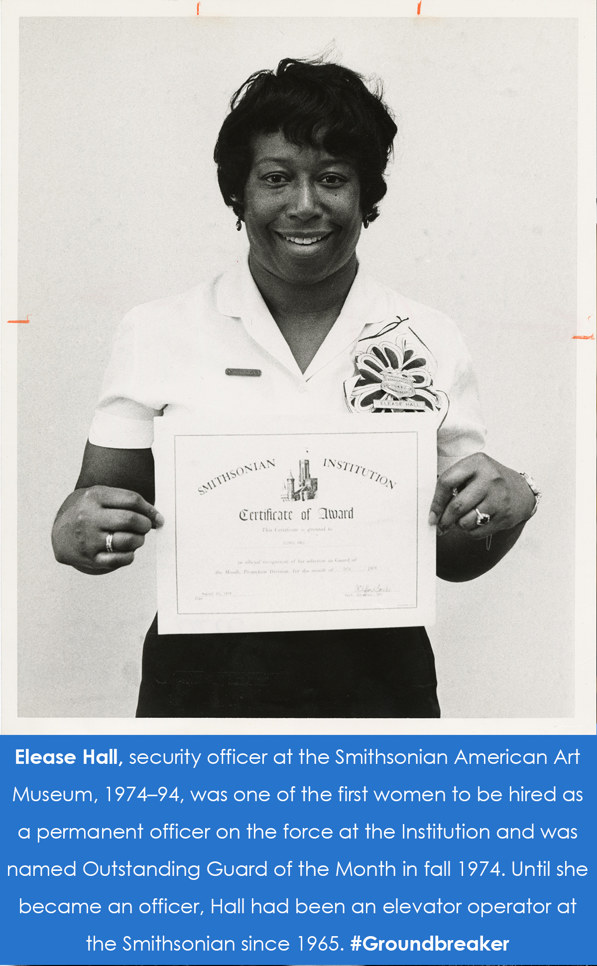 Hall holds up the Guard of the Month certificate.