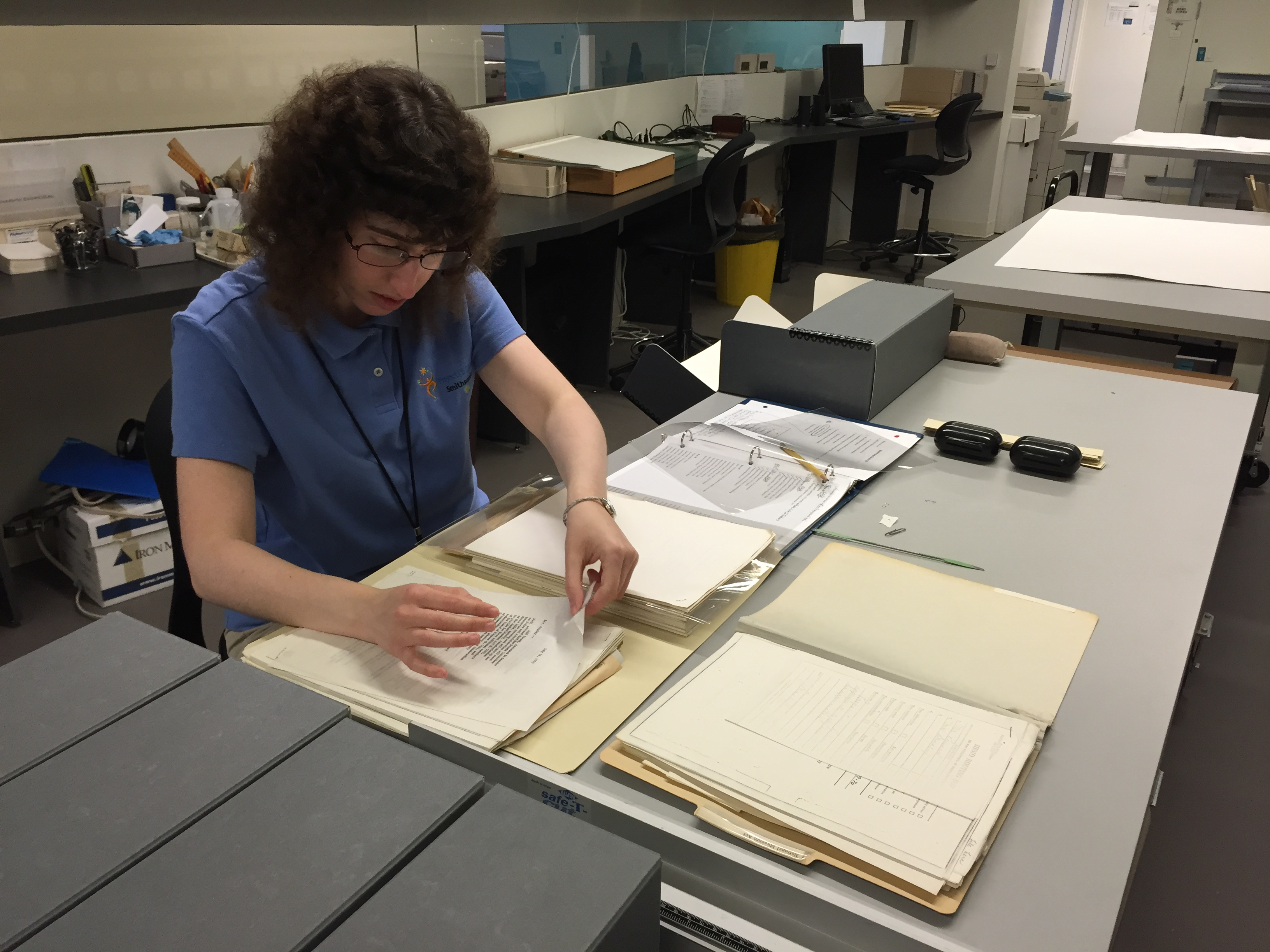 Reviewing documents as they are transferred from old boxes to new, and flagging any items that need further review or intervention from the conservation staff.