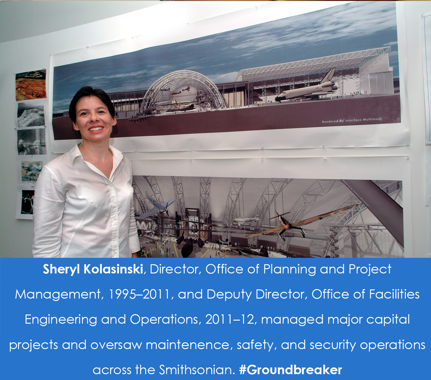 A woman stands in front of renderings of the Udvar-Hazy Center that are hanging on the wall.