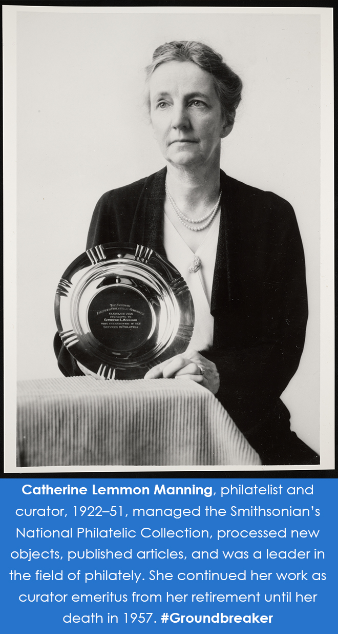 Photograph of Manning holding up an award in the shape of a round dish.