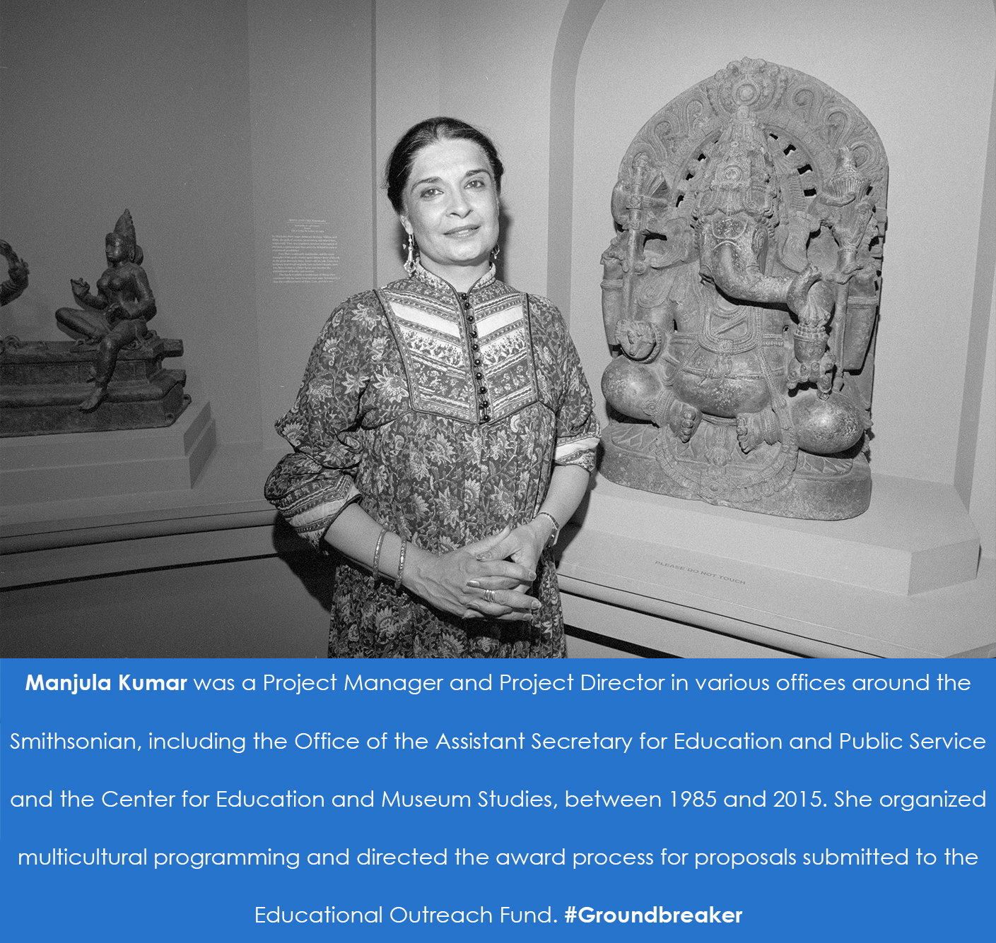 Manjula Kumar standing in front of a sculpture of Ganesha, the Hindu symbol of good fortune.