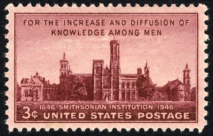 Stamp with a red-ish brown tone that features the Smithsonian Institution Building. The text reads: