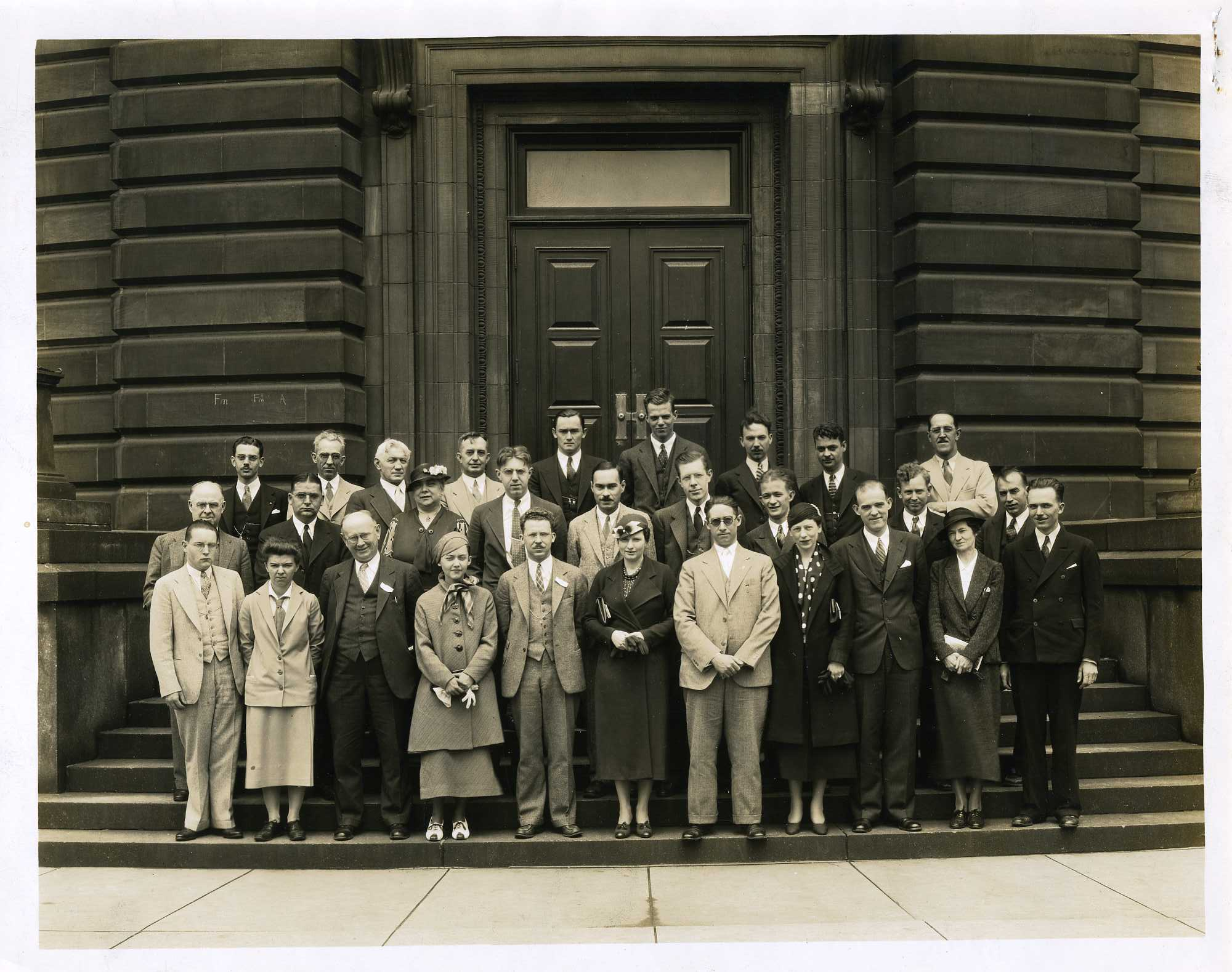 Let this 1935 photo serve as our control group. Note the men are wearing suits, vests, and ties. The