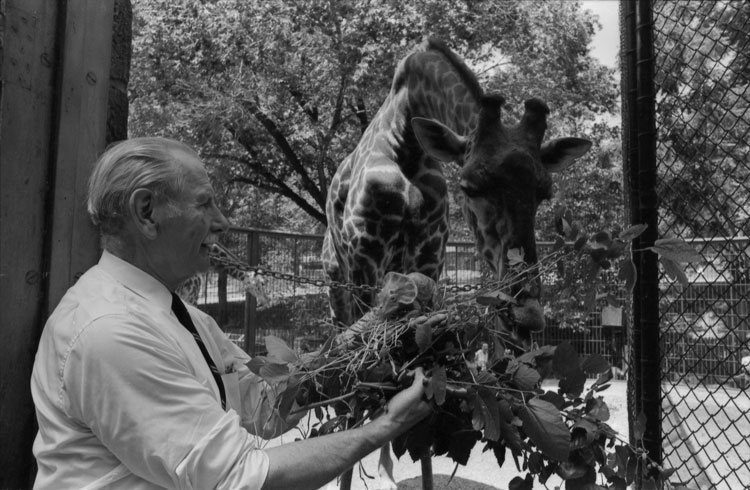 Louis Paul Jonas with Giraffe