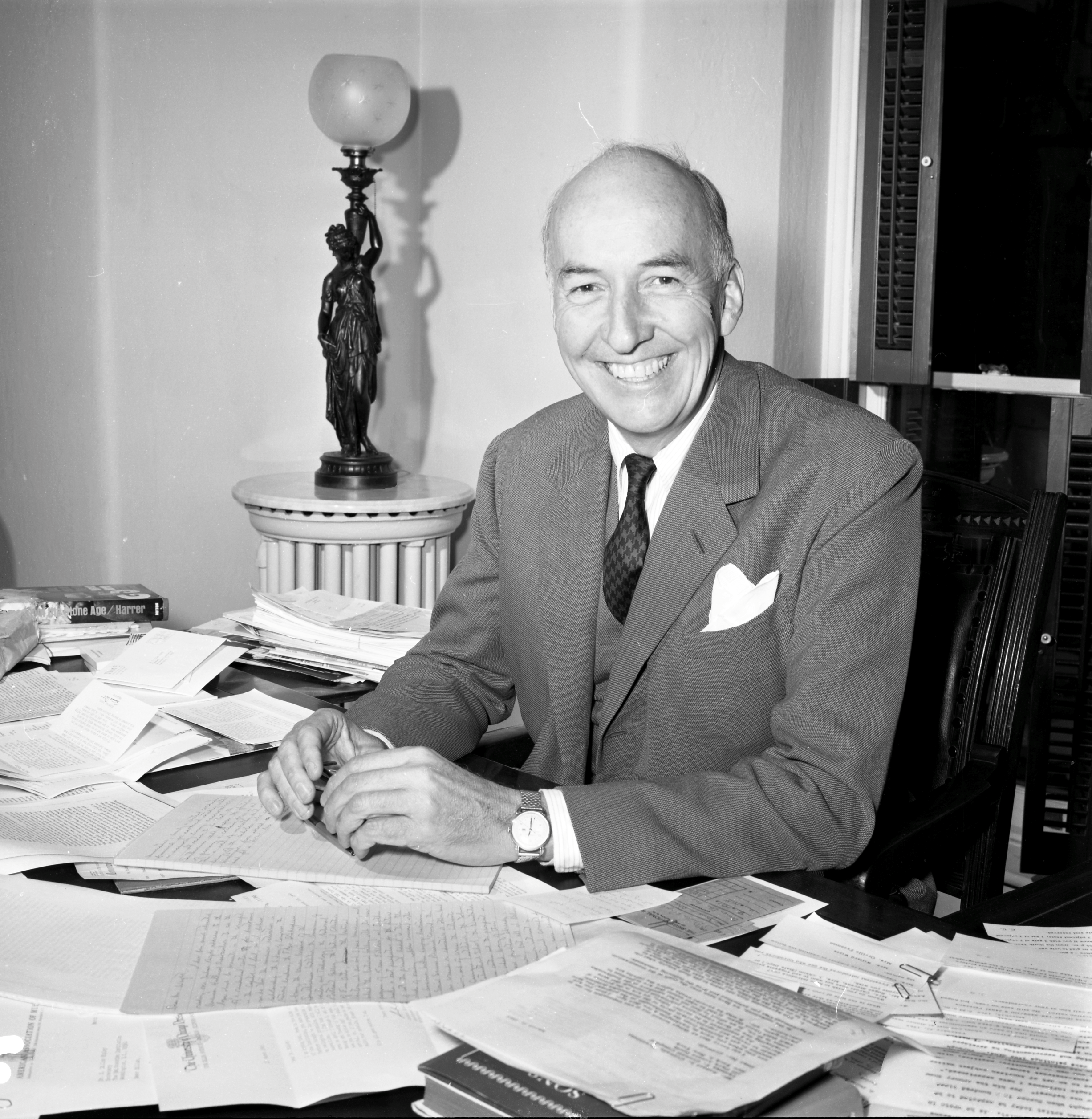 Secretary S. Dillon Ripley at desk.