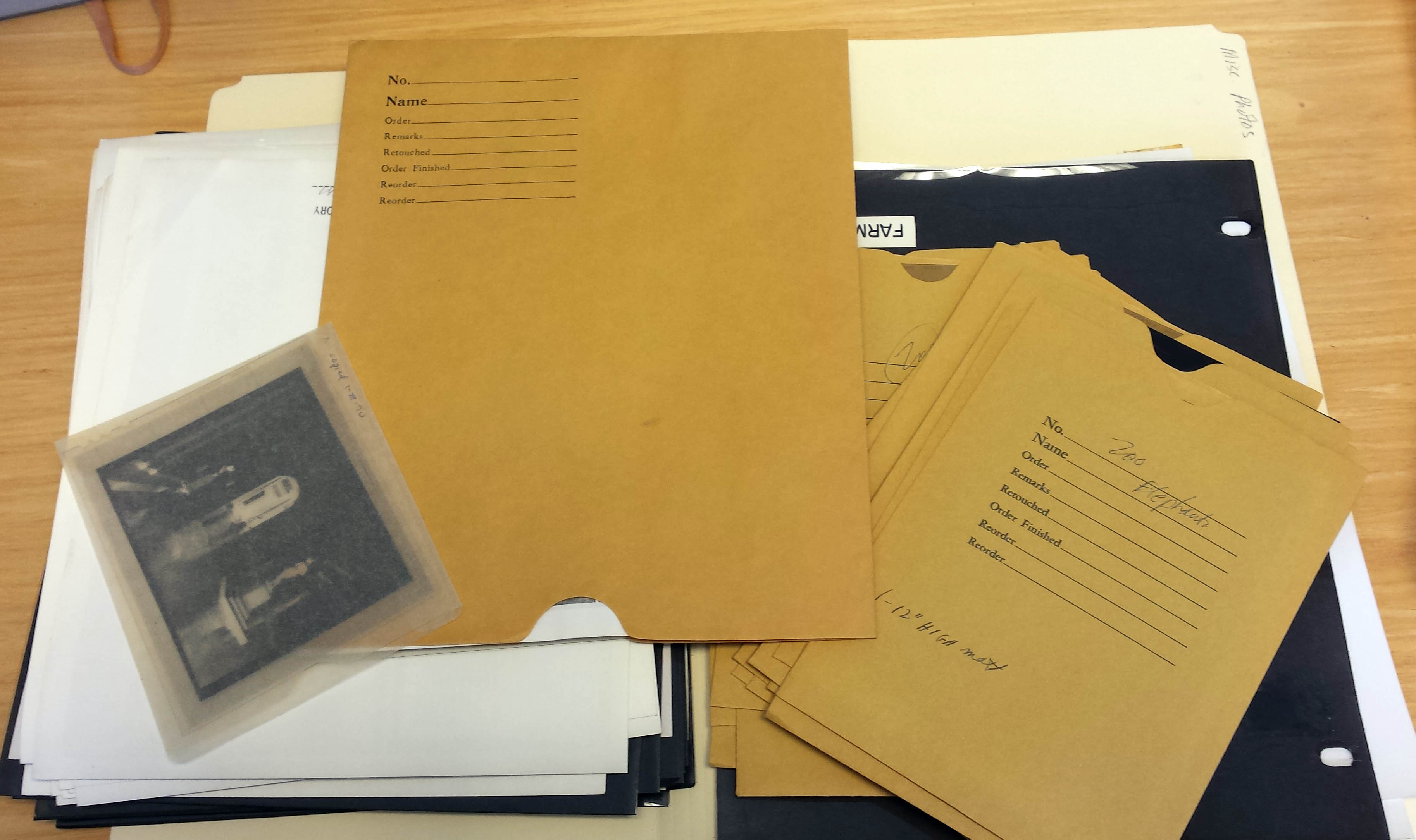 """Image of the contents of the folder """"Miscellaneous Photographs,"""" 2014, by Courtney Bellizzi."""