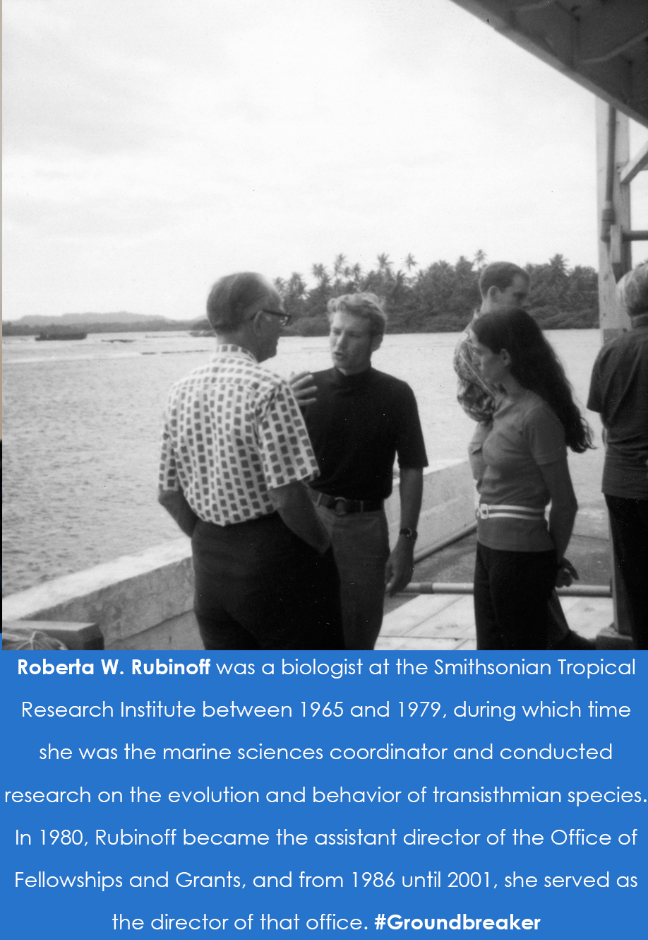 Photograph of two men and one woman standing in a group. The caption reads: Roberta W. Rubinoff was