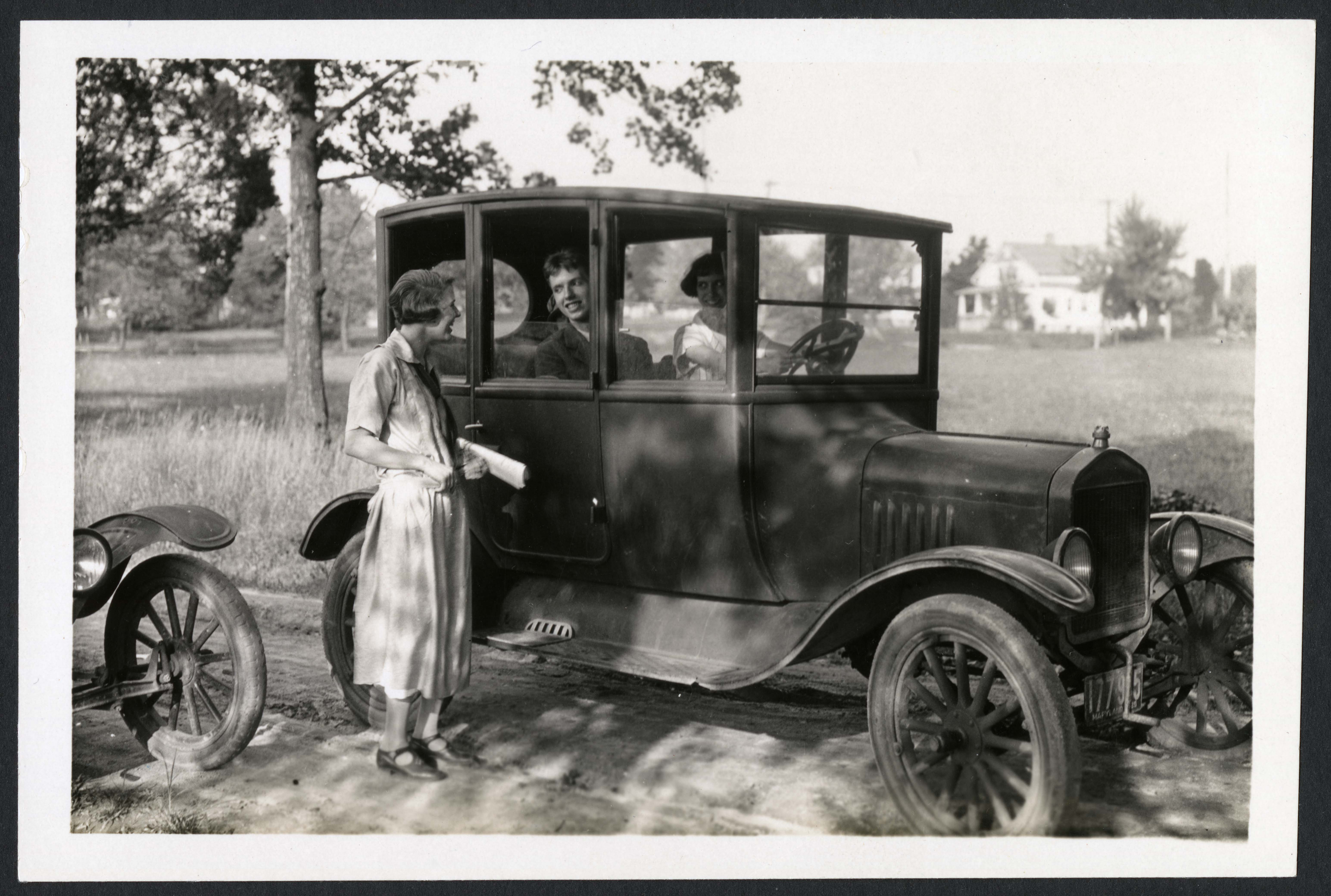 Alice Haines (outside at left), Robert Spencer Ward, and Thelma Hunt (at right, behind the wheel), p