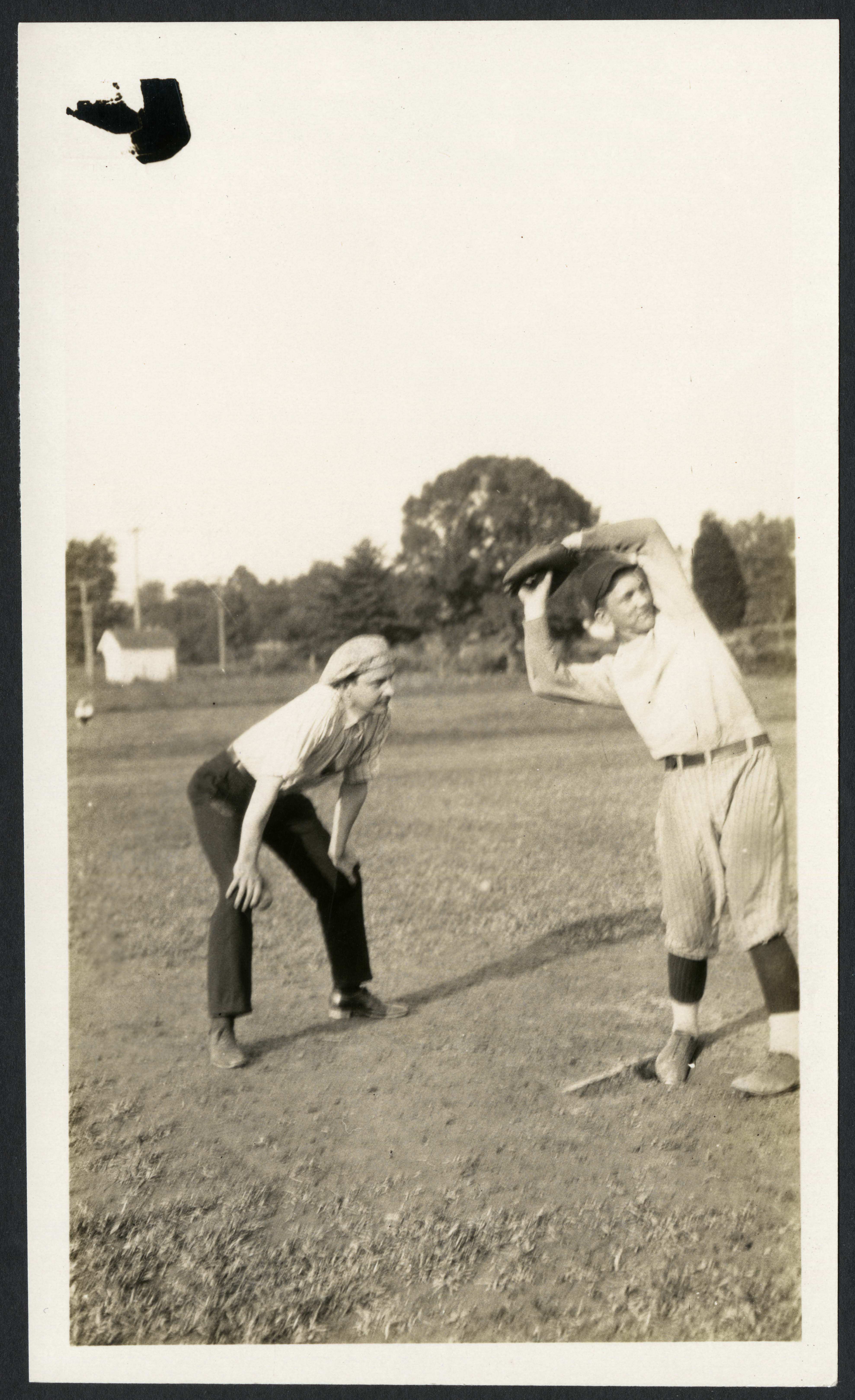 "Fred August Moss (at left) umpires a softball game as part of the George Washington University ""Slee"