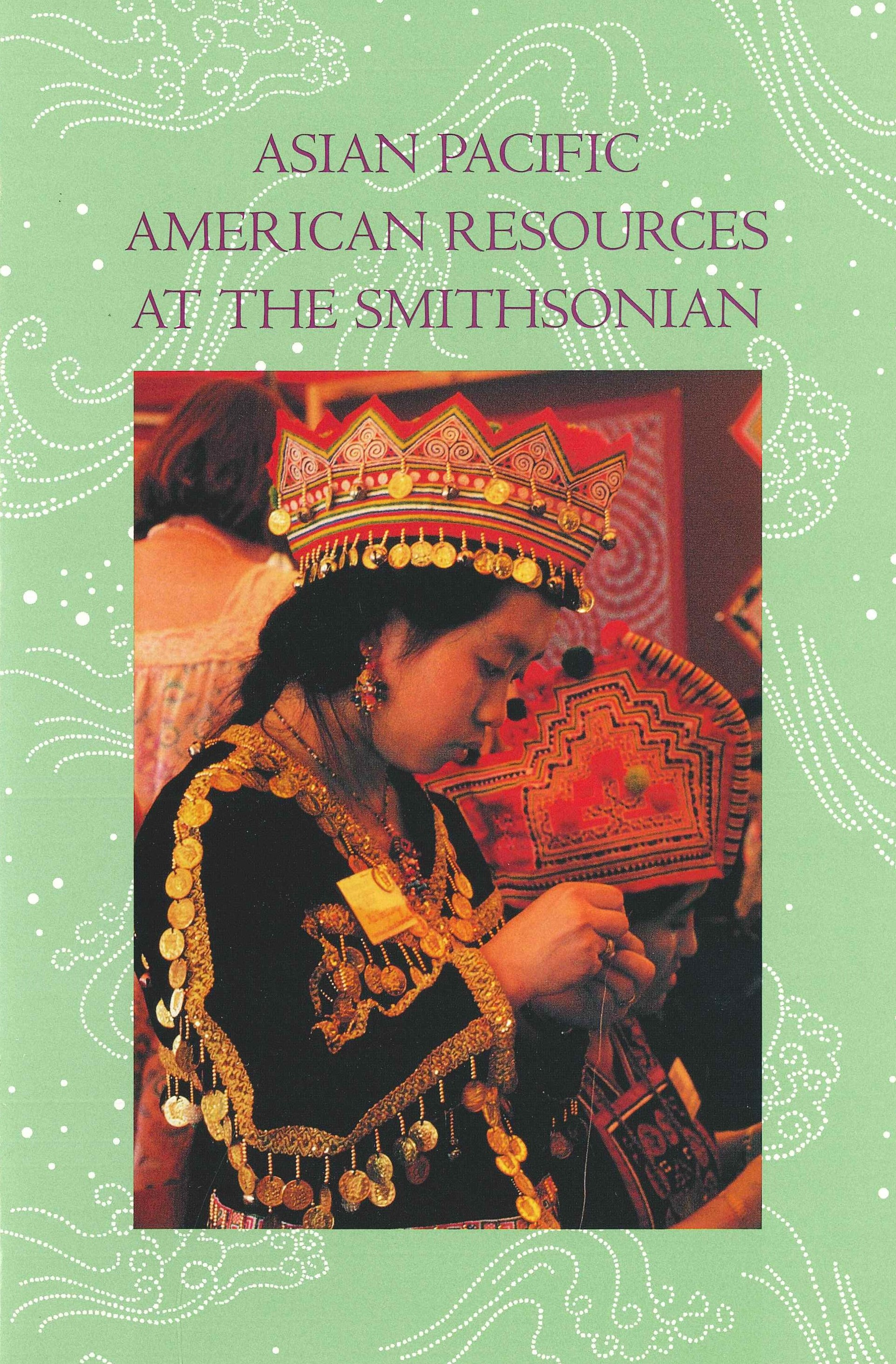 Brochure with light green cover with patterns on it with color image of individual in Hmong embroide