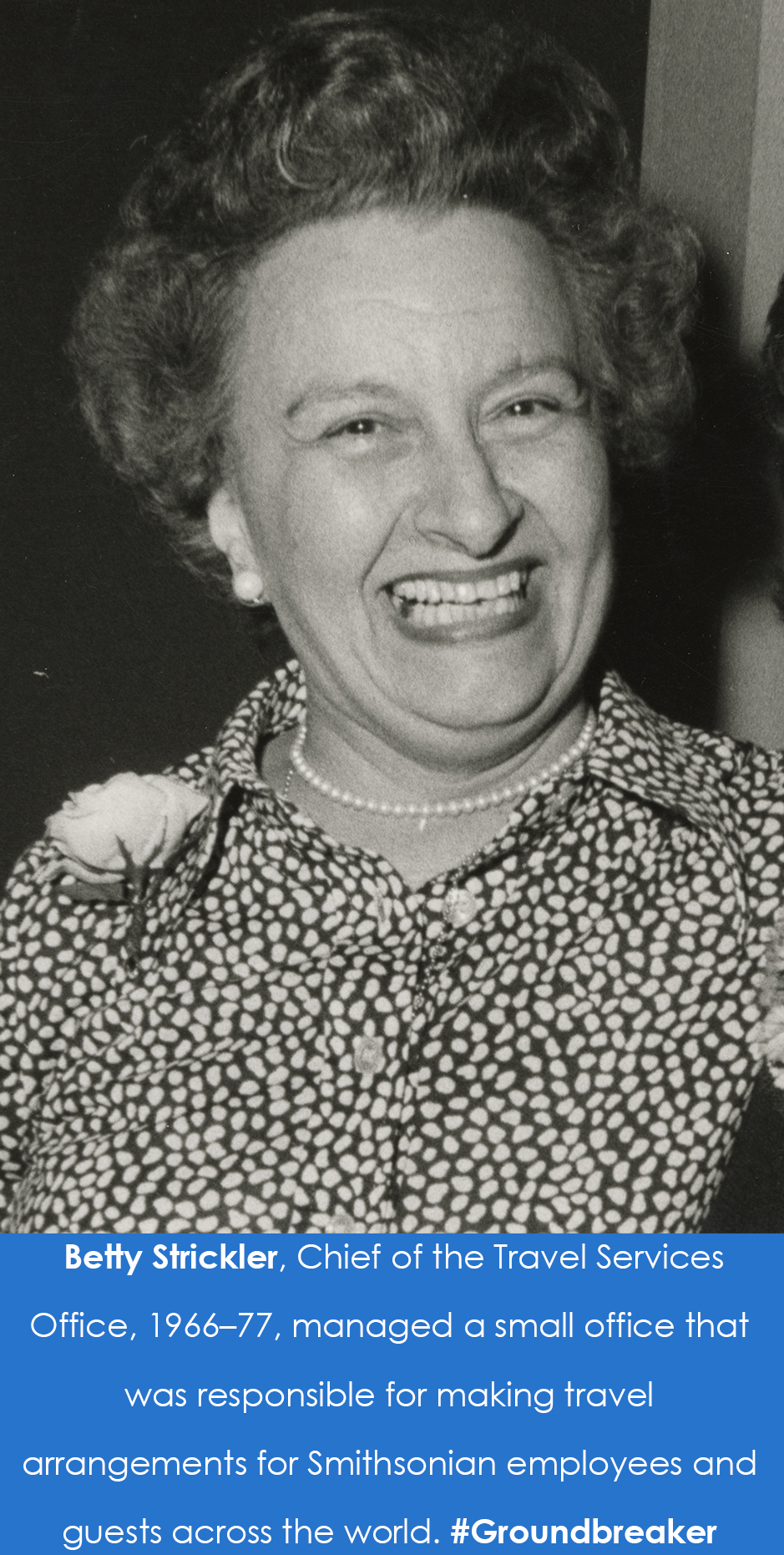 Photograph of a woman smiling broadly.