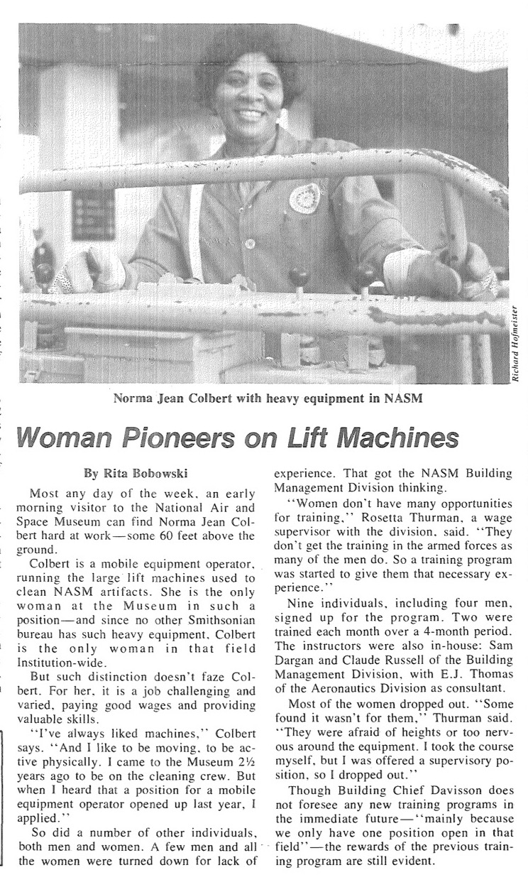 A photo of a woman smiling and operating heavy machinery at the Smithsonian