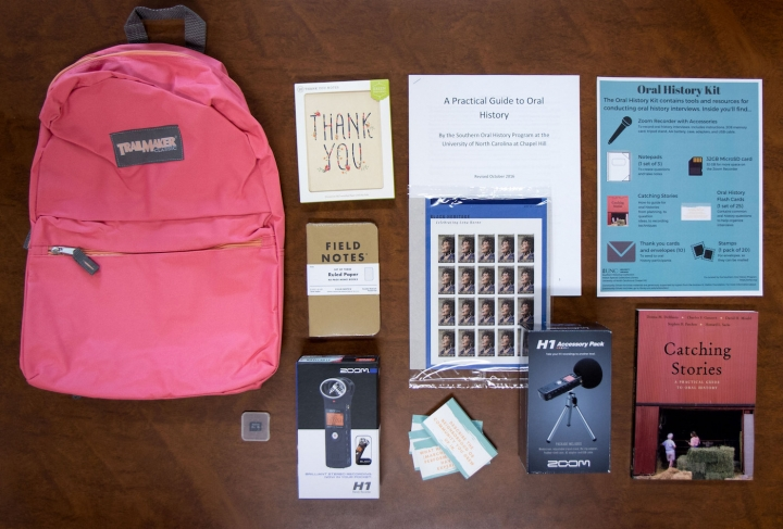 Pink backpack, field notes notebooks, microphone, audio recorder, and guides on recording oral histo