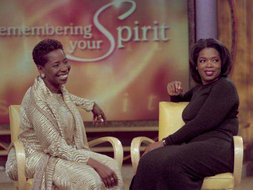 "Two African American women on Oprah's stage with ""Remembering Your Spirit"" headline in the backgroun"