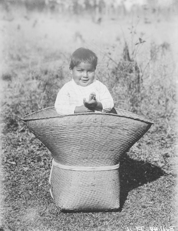 Two-Year Old Boy Sitting in Basket 1909, NAA INV 06226600, Glass Negative, National Anthropological