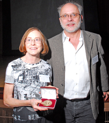 Dr. Beryl Simpson holding an award and standing next to Laurence J. Dorr.
