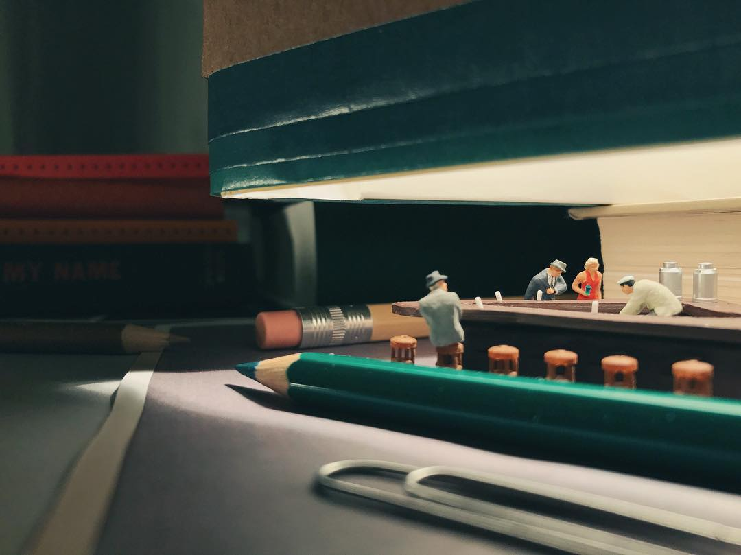 Miniature version of Hopper's Nighthawks with pencils and other office supplies.