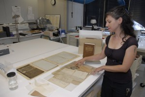Smithsonian Institution Archives' Paper Conservator, Nora Lockshin, with the Diary of Adam Francis P