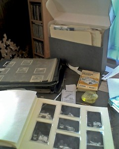 The original black-paged album, a document box with archival file folders for historic documents and