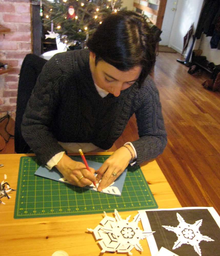 <p>Smithsonian Archives employee, Effie Kapsalis, tracing a Bentley-inspired snowflake.</p>