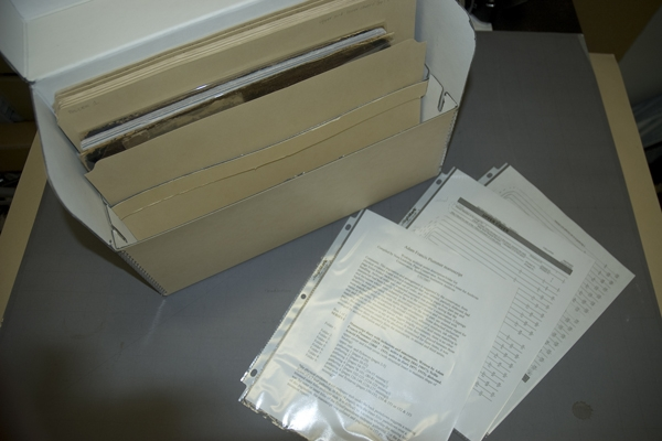 Manuscript sections, sewn in pamphlets and stored in folders in a document box, with the facsimile t