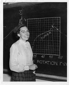 Mary Blade, standing at blackboard, Unidentified photographer