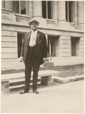 George Gustav Heye posed in front of the Museum of the American Indian/Heye Foundation, 155th and Br