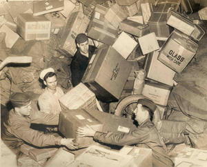 US Troops Surrounded by Holiday Mail During WWII, Unidentified photographer