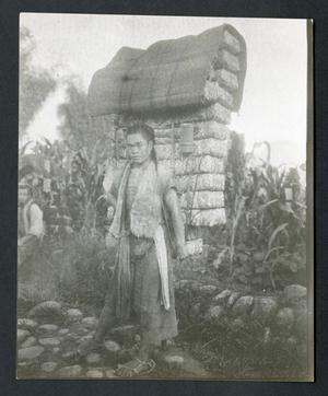 A Chinese coolie [sic] carrying 288 pounds of tea and a twenty pound rack. Taken by David Crockett G