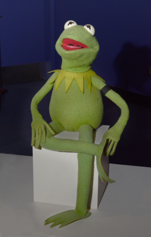 Kermit the Frog is wearing a black armband in honor of the memory of Jane Nebel Henson. He is on dis