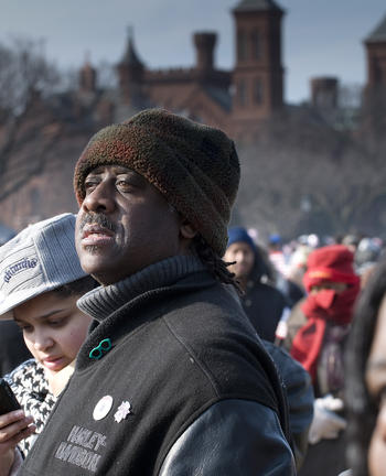 Inauguration visitor with Smithsonian Castle in background, January 20, 2009, by Michael Barnes, neg