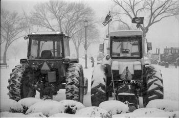 Tractors covered in snow from the Presidents Day weekend blizzard