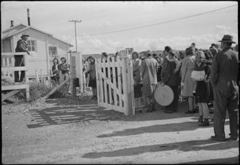 Topaz, Utah. Luther E. Hoffman, Project Director at the Central Utah Relocation Center, is shown spe
