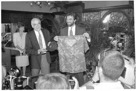 Tom Selleck donates a red Hawaiian-print shirt, two blue baseball caps.
