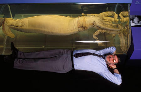 Zoologist Clyde Roper poses next to a giant squid.