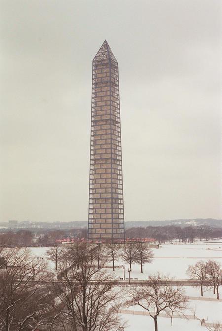 Scaffolding surrounds the Washington Monument.