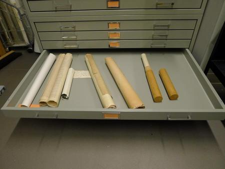 Rolled documents that need to be flattened.