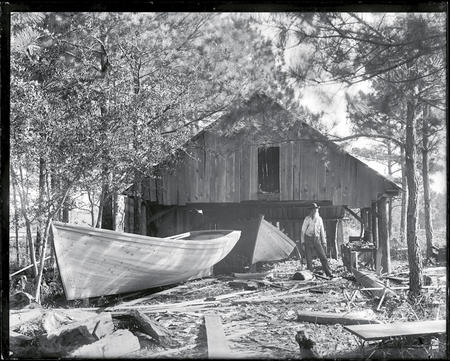 A boatbuilder at his workshop.