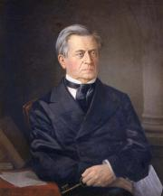 Painting of Joseph Henry seated, dressed in a dark suit, with a key in one hand and a piece of paper