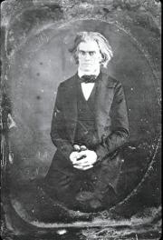 Image of John C. Calhoun, sitting down, wearing a dark suit.