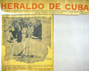 Image of Cuban newspaper, with black and white photographs of a ship and of men in back and white su