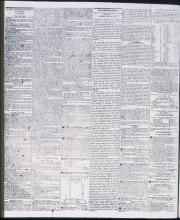 Inside sheet of a newspaper, black printed text on light background