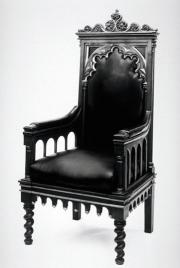 Black and white image of one of Renwick's armchairs with gothic carvings