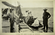 Black and white image of a landing party of men standing and sitting on a small boat that is about t