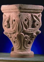 Photograph of sandstone carved capital with swirling patterns